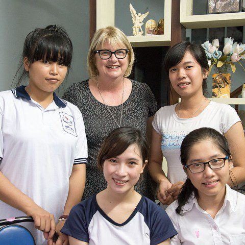 Executive Officer Kim Nass with four students receiving a MWIA funded scholarship in Vietnam.