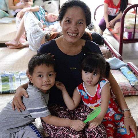 A mother and children at the Tan Phu Women's Shelter in Ho Chi Minh City, Vietnam. MWIA helps to fund this shelter which provides support for young, vulnerable, unmarried pregnant women who have come to the city from rural areas.