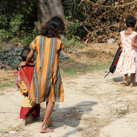 Children in Kolkata India travelling to school.