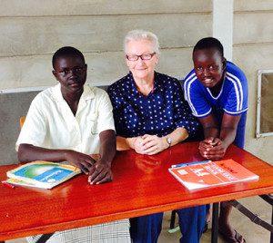 loreto-sister-maureen-burke-helping-students-with-their-homework
